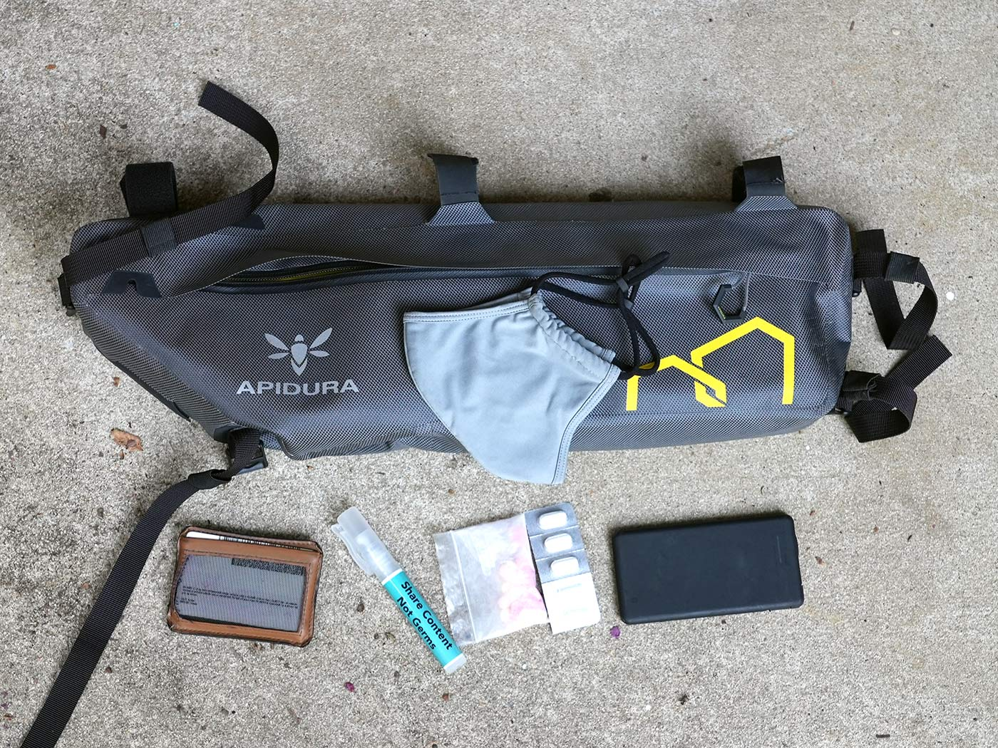 contents laid out showing what all will fit inside the apidura expedition frame pack