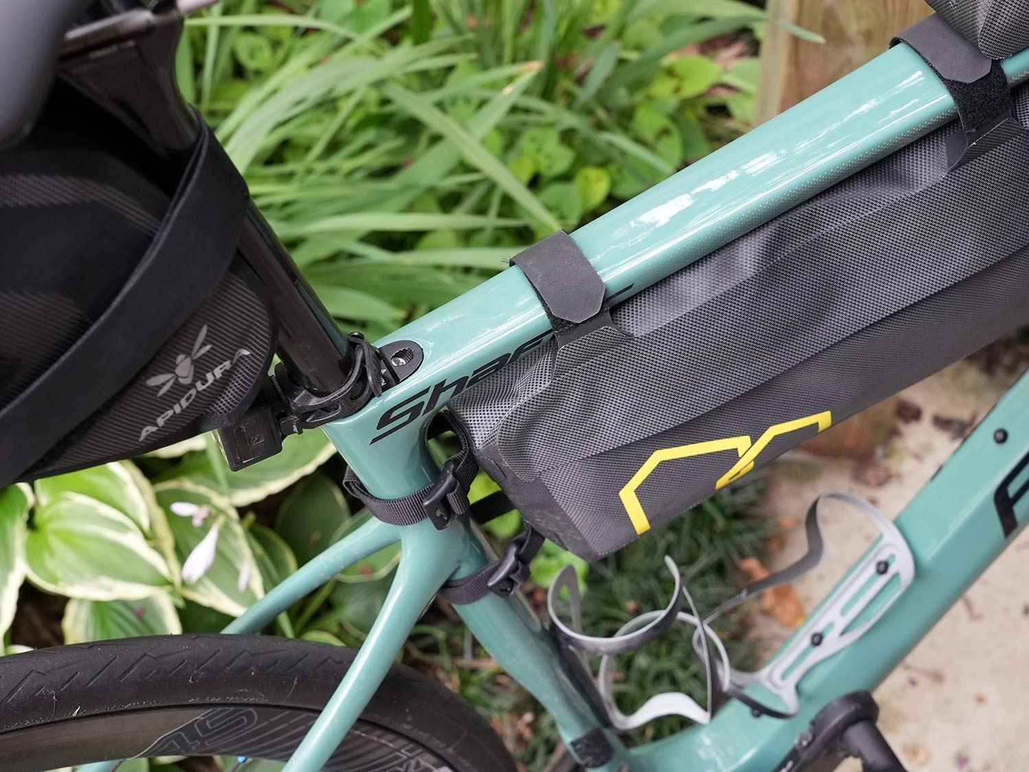 apidura expedition frame pack on a bike