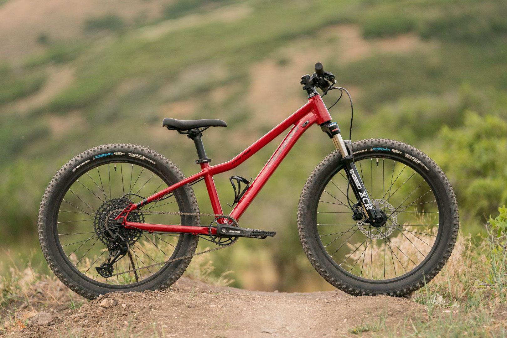 fezzari lone peak kids mountain bike shown from side in red