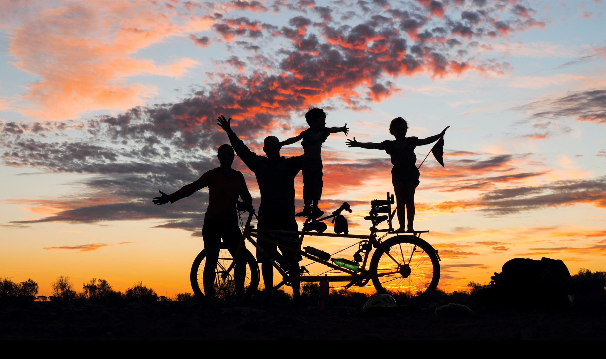 family bicycle sunset