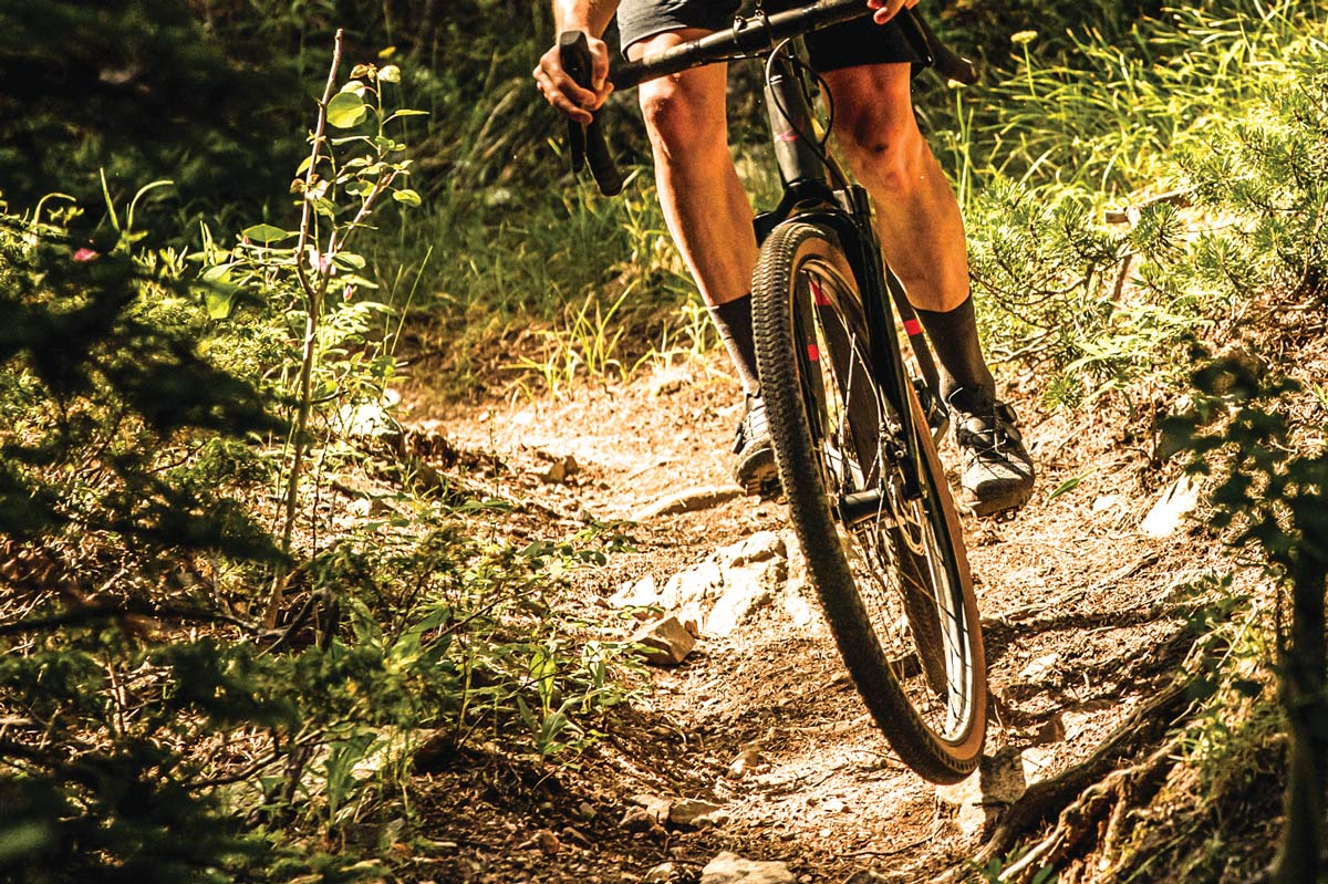 zipp 101 xplr moto wheels shown on a gravel bike riding singletrack