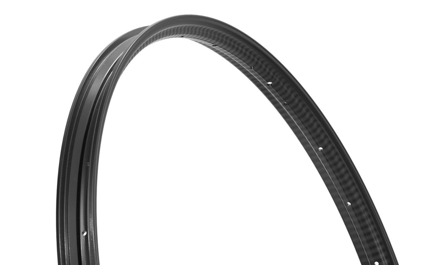 closeup of single-wall carbon fiber rim on zipp 101 xplr gravel bike wheels