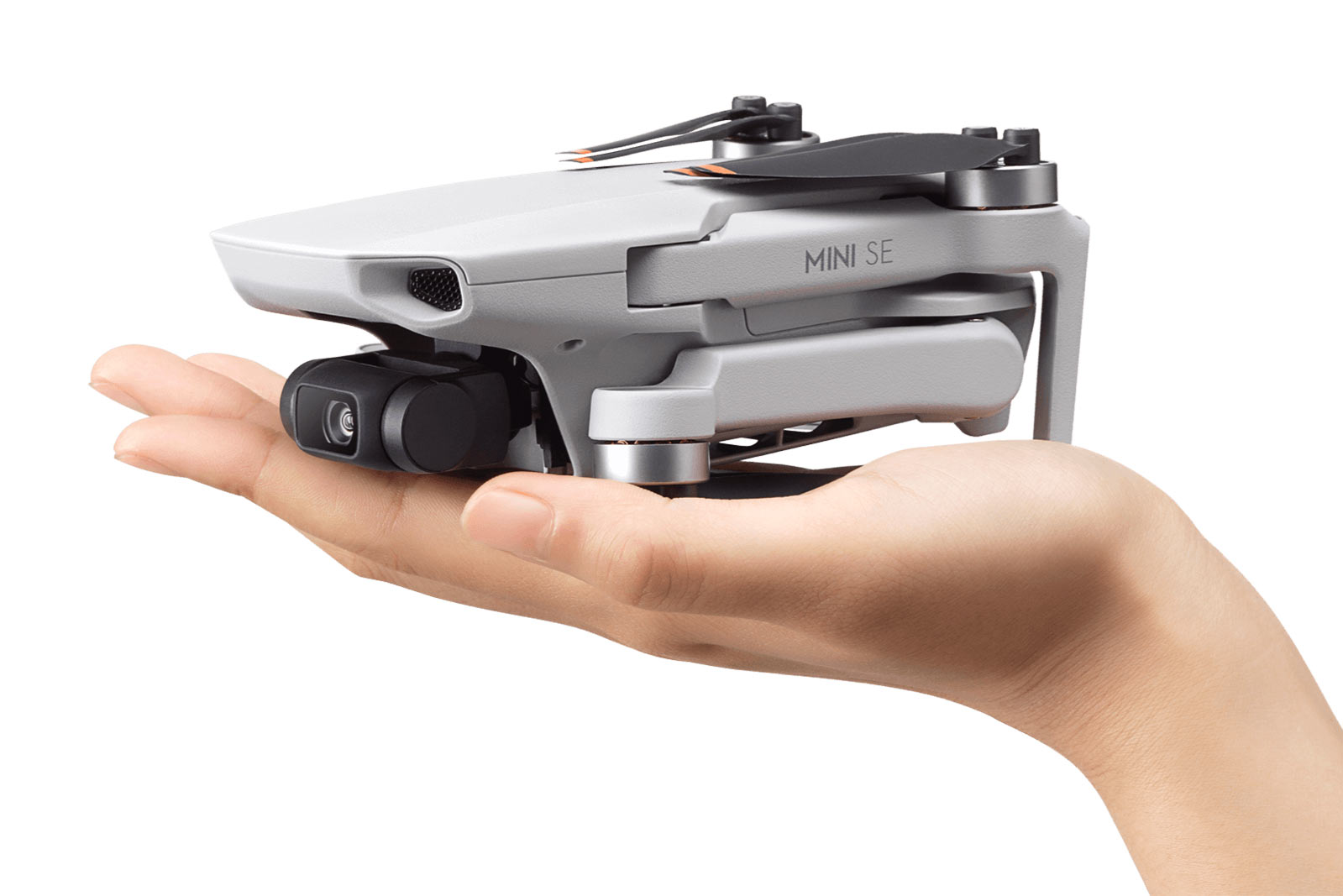 dji mini se drone in the palm of a hand