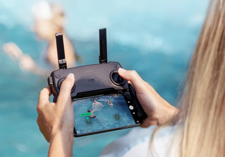 dji mini se remote control with smartphone attachment