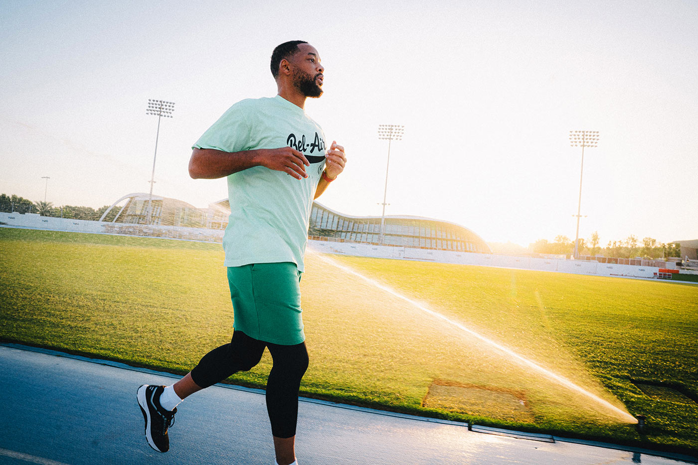 will smith jogging with a fitbit charge 5 fitness tracker