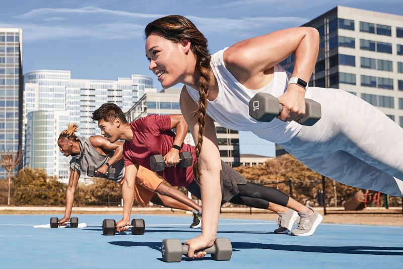 group of people working out with new fitbit charge 5 fitness tracker smartwatch