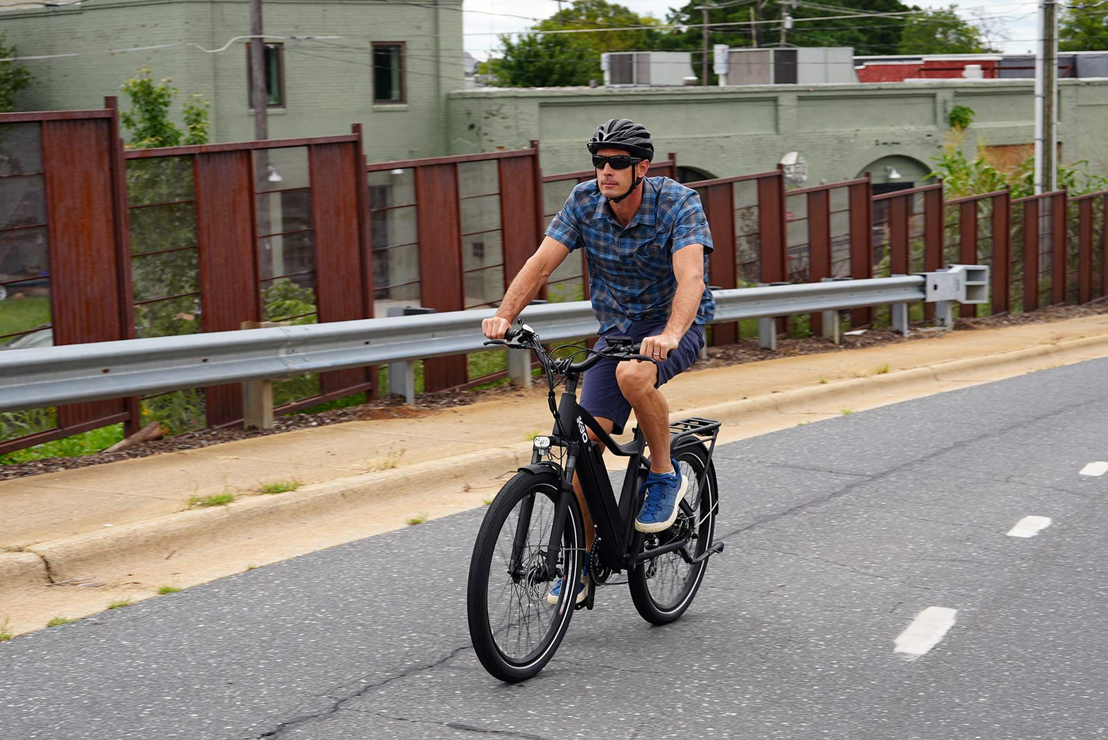 riding up the street for the kbo commuter e-bike review