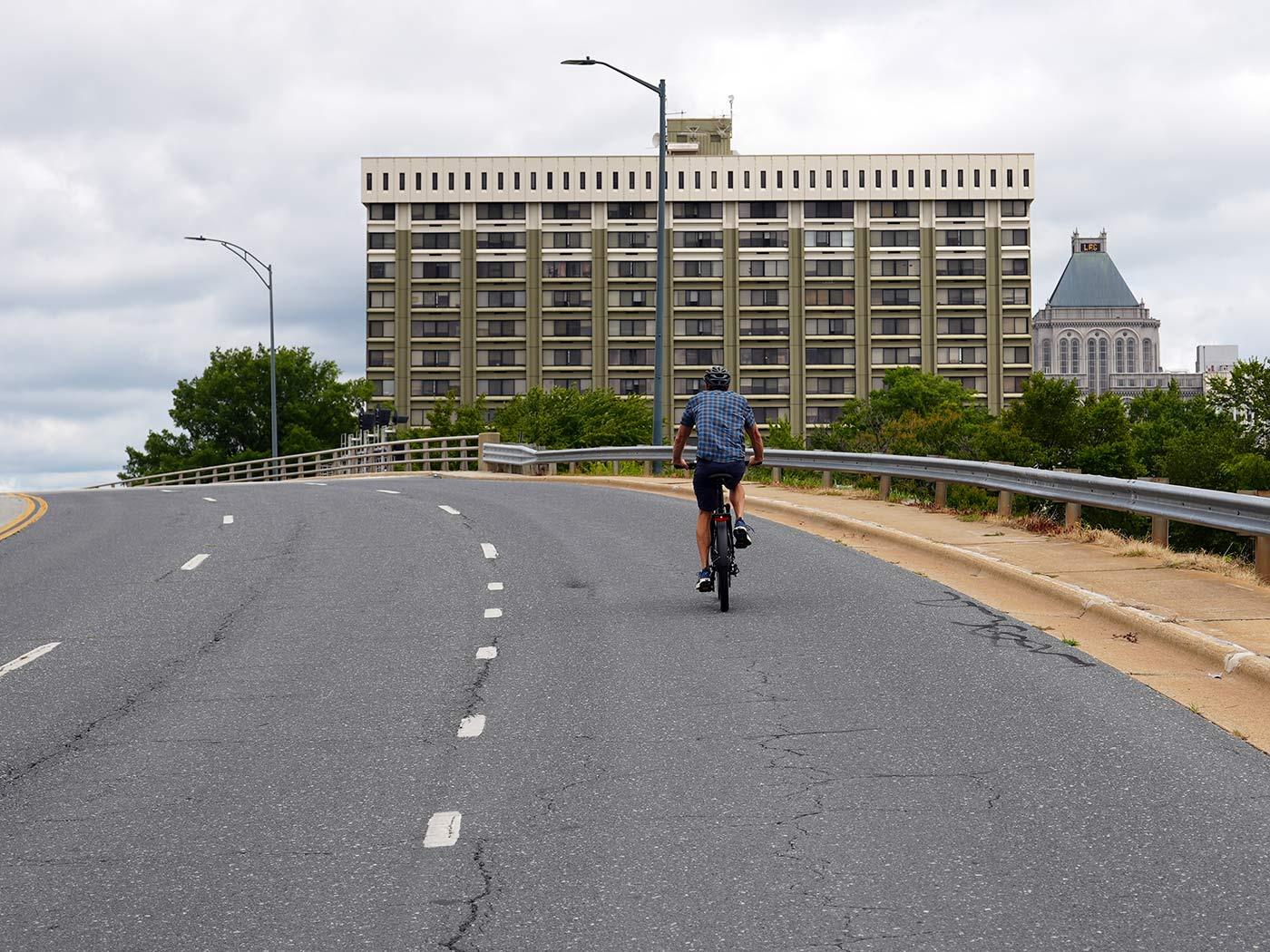 riding up a bridge on the KBO e-bike