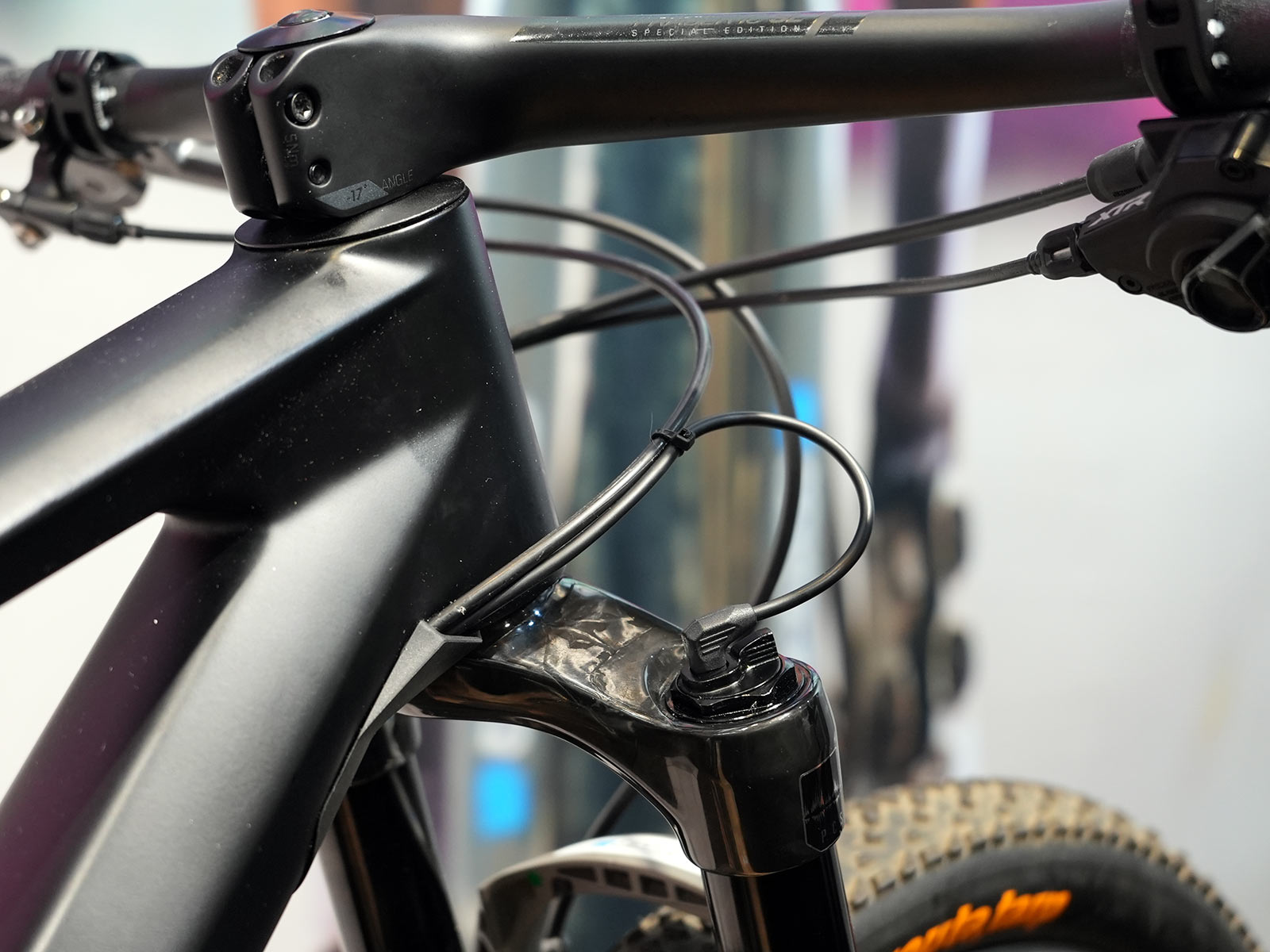 closeup of prototype electronically controlled suspension on tom pidcock's olympic mountain bike