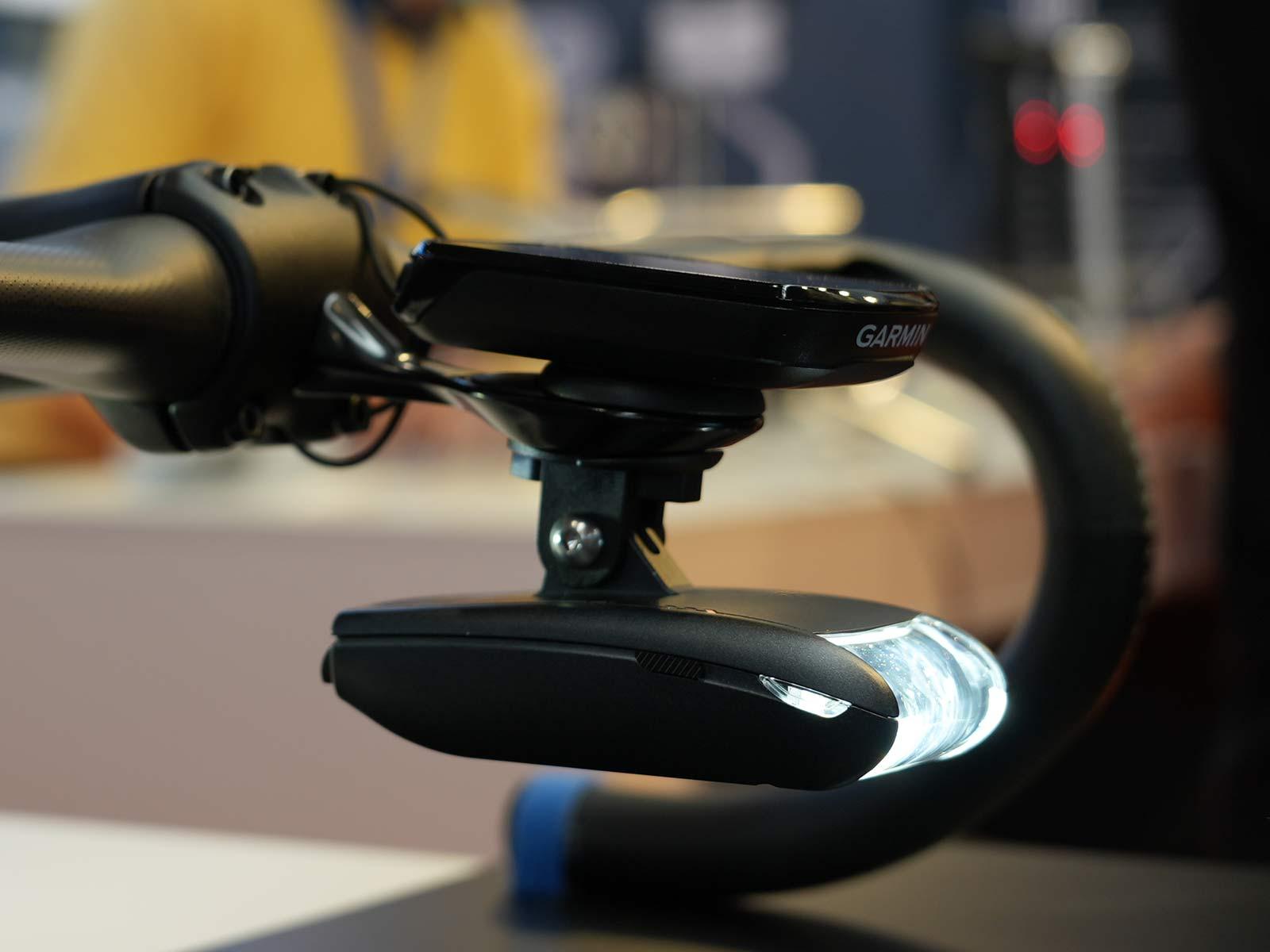 lightskin naca profile aerodynamic road bike headlight with gps cycling computer installed above it