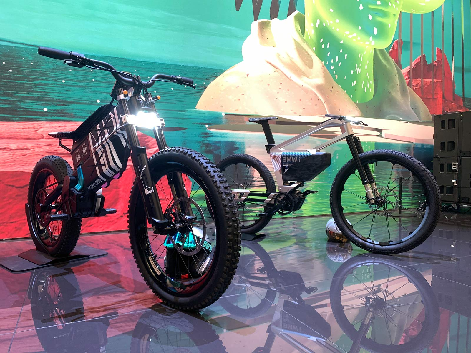 BMW electric moto dirt bike concept with eMTB prototype behind it