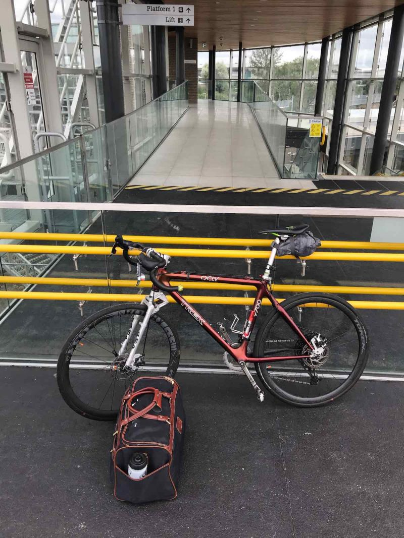bikerumor pic of the day a bicycle is inside a train station next to a bag packed for a weekend in worcester parkway uk