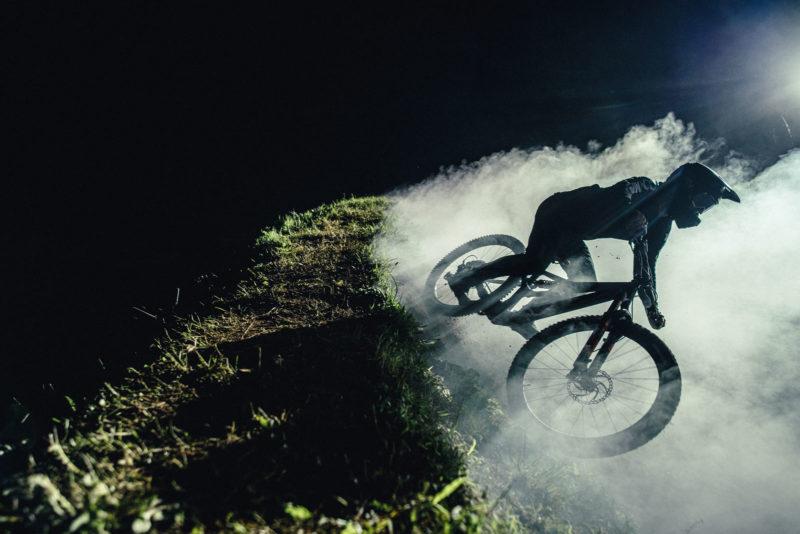 2022 orbea rallon night riding berm dust cloud lit up