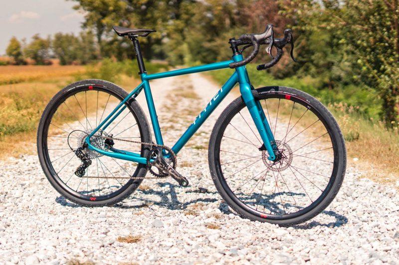 Titici All-In aluminum gravel bike, integrated custom alloy bike made-in-Italy, photo by Mattia Ragni,angled complete bike