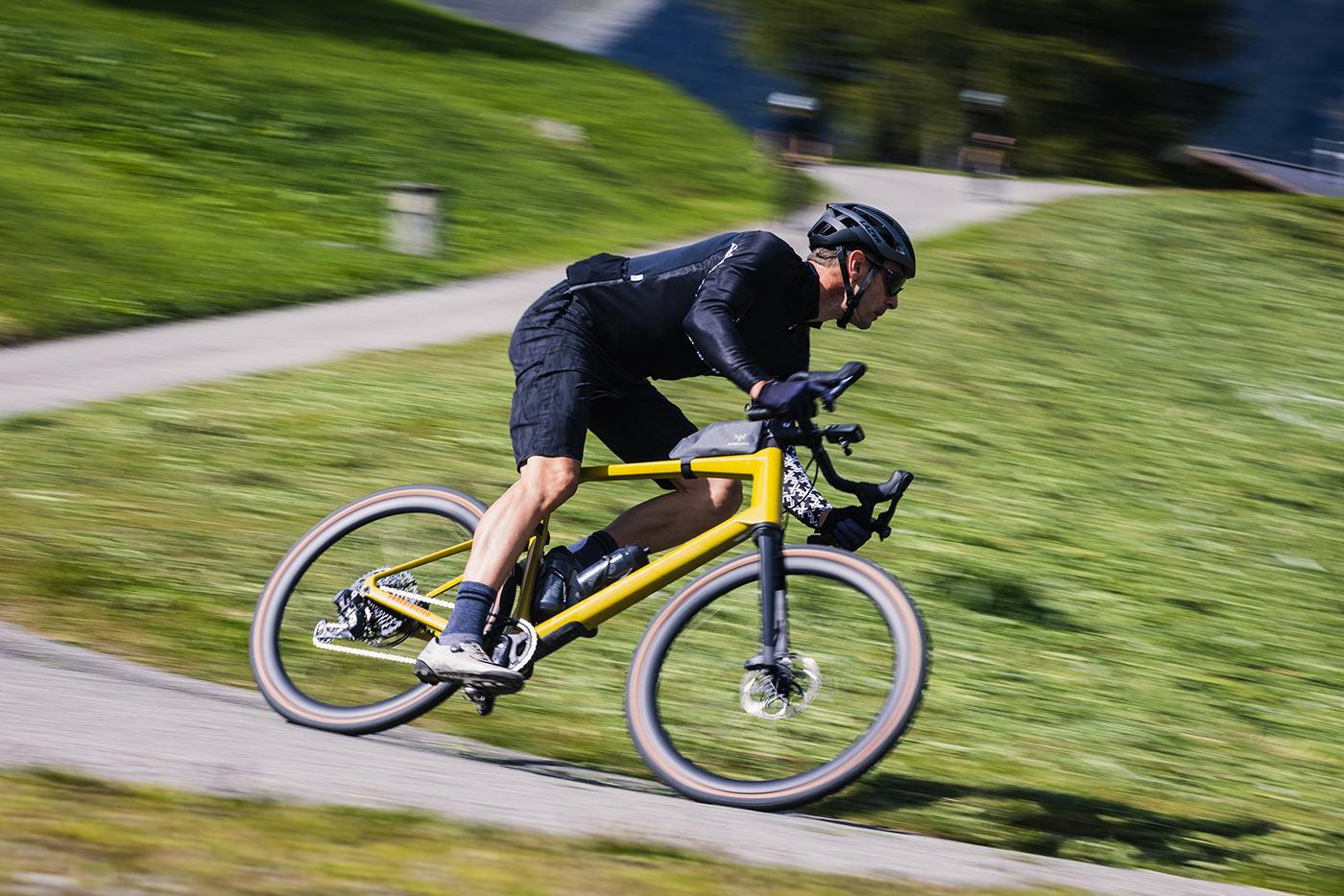 high speed cornering on the bmc urs lt full suspension gravel bike on the road