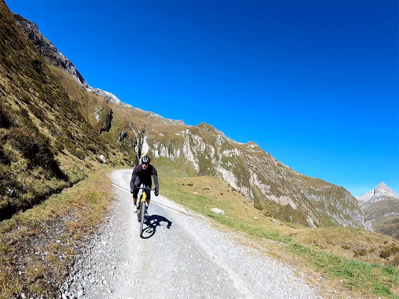 bmc urs lt full suspension gravel bike review ride down a mountain pass in switzerland