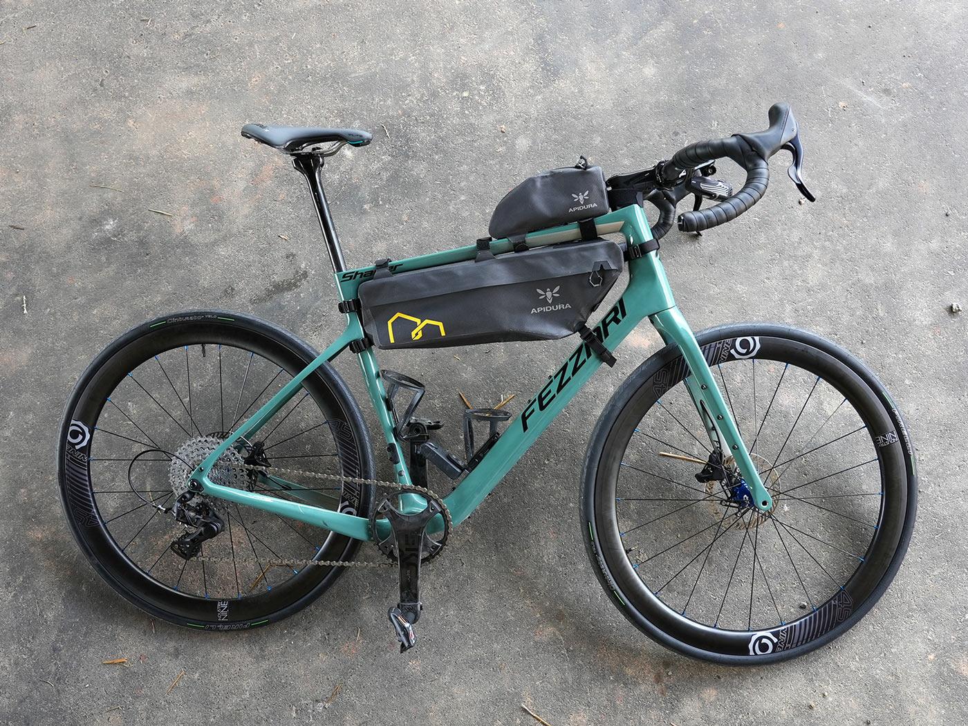 fezzari shafer gravel bike with road wheels and frame bags
