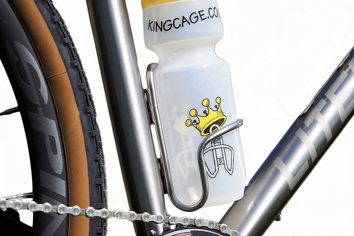 king cage side loader water bottle cage for left or right side water bottle removal shown on a bike