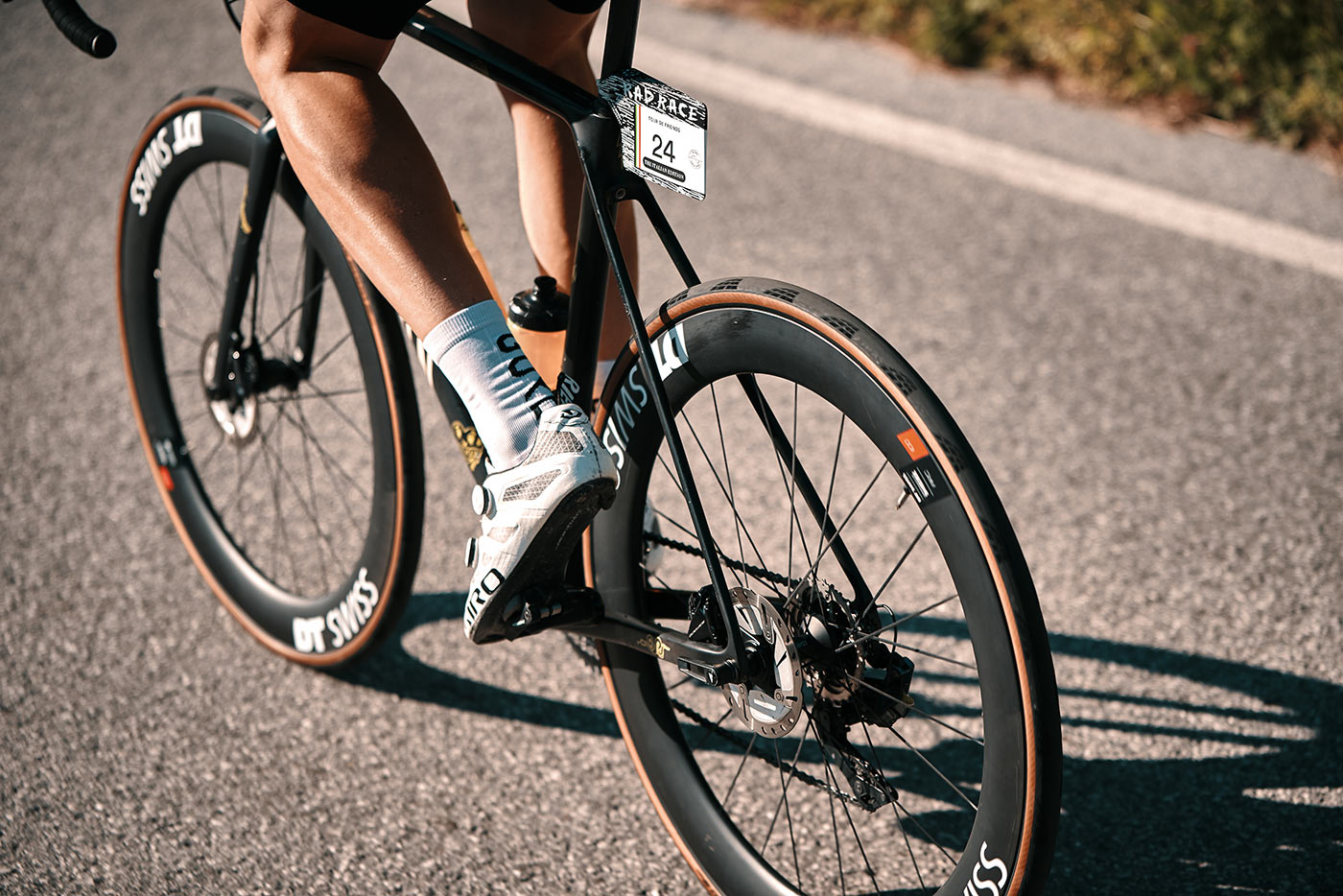 rider on a bike with the new tubeless ready Continental Gran Prix 5000 S TR road bike tire