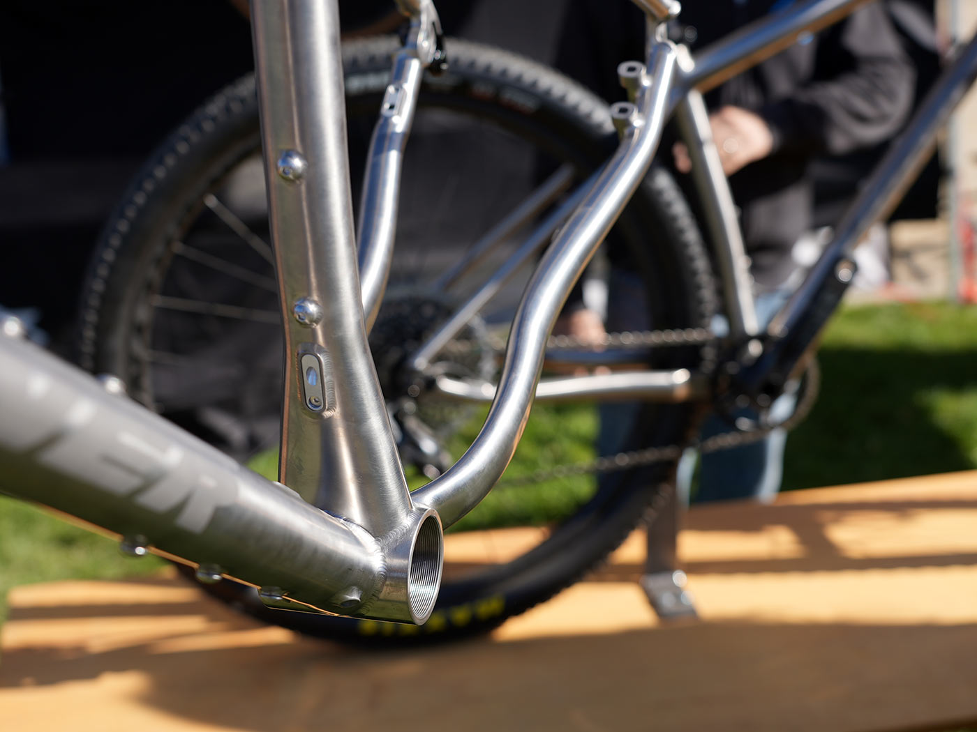 seat tube and bottom bracket junction closeup on 2022 turner cyclosys titanium gravel bike