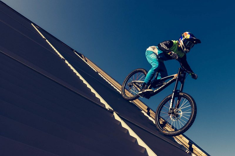 Getting a sense of scale for the Red Bull Rampage, photo by William Saunders, Jaxson Riddle rides off a 4-story building