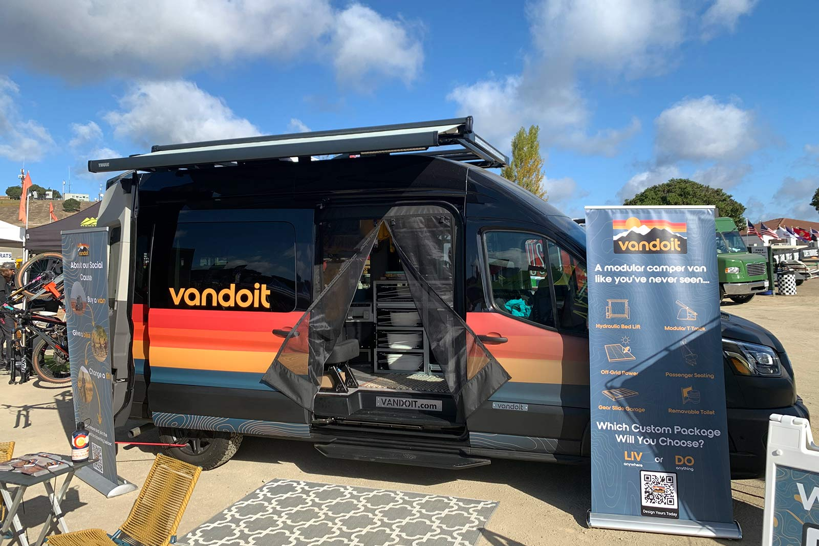 vandoit custom camper van with modular interior and slide-out bike tray and workstand