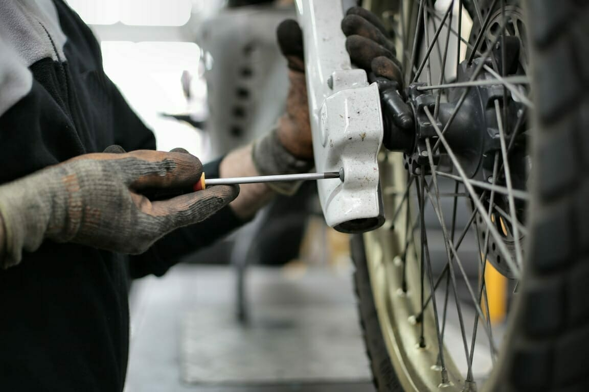 Someone repairing a dirt bike   Bulk wire   Safety Wire