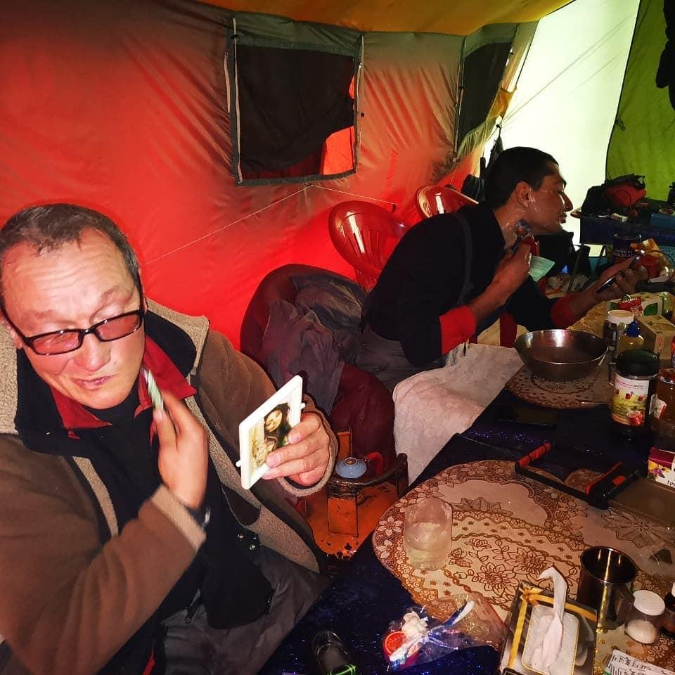Russian/Kazakh/Kyrgyz team members shaving before heading up on winter K2