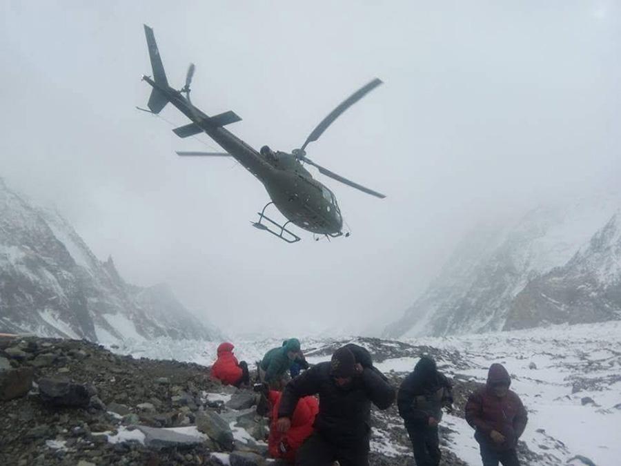 Chopper landing on winter Nanga Parbat Base Camp