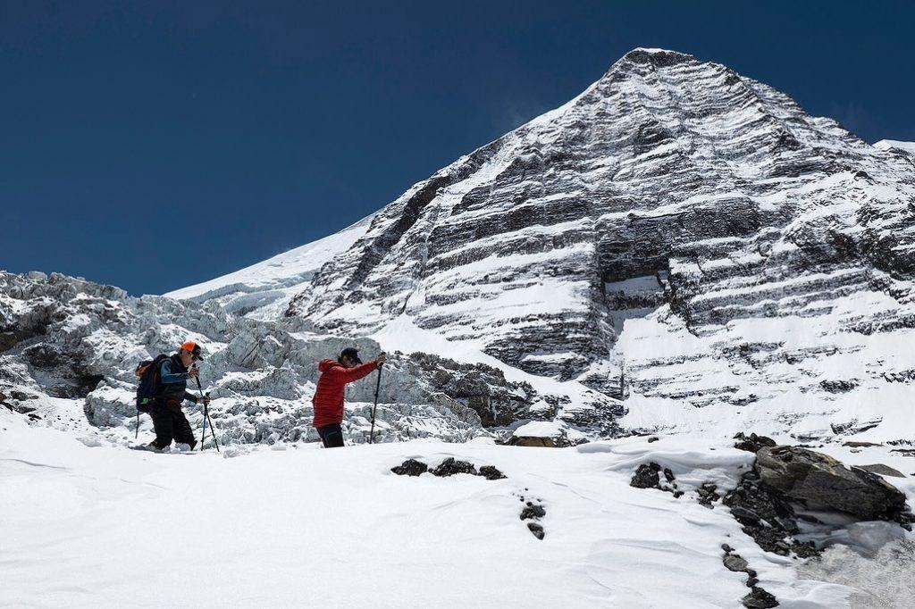 Trekking through fresh snow near Dhaulagiri Base Camp.