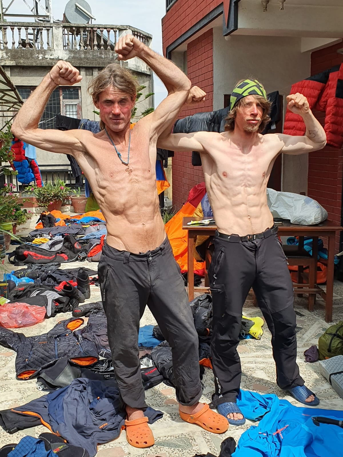 Two super-skinny climbers show their bones and muscles