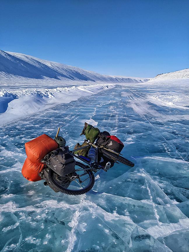 A bike lying on a bare ice road
