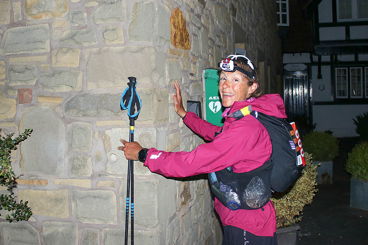 Anna Troup touches the wall at the Border Hotel in Kirk Yetholm