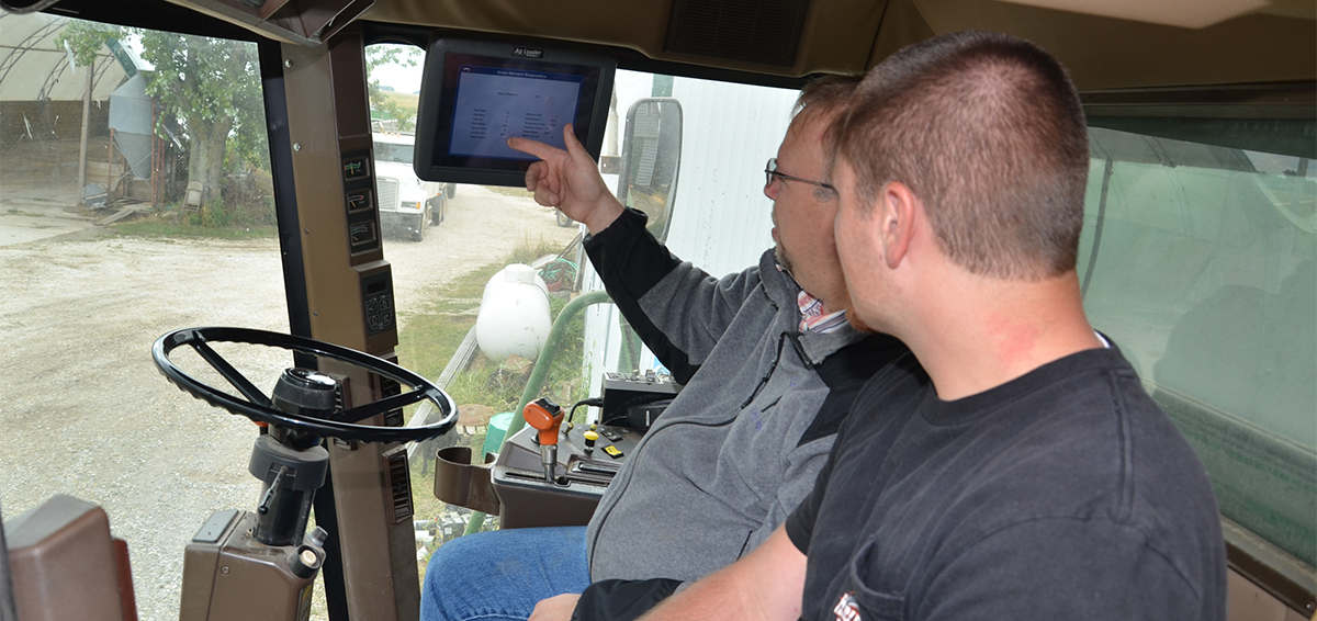 ECC precision agriculture instructor with student