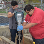 Jonathan Ortega and Joseu Ruiz worked on flower beds and vegetable gardens at Rogers Elementary School.