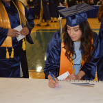Signing the 2017 graduation banner.