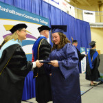 Student is congratulated by Dr. Robin Lilienthal.