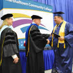 Steve Adelmund is congratulated by Dr. Chris Duree.