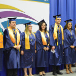 Honors students on stage.
