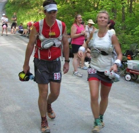 An upbeat Olga passes her husband Larry at the 2010 Mansanutten 100.