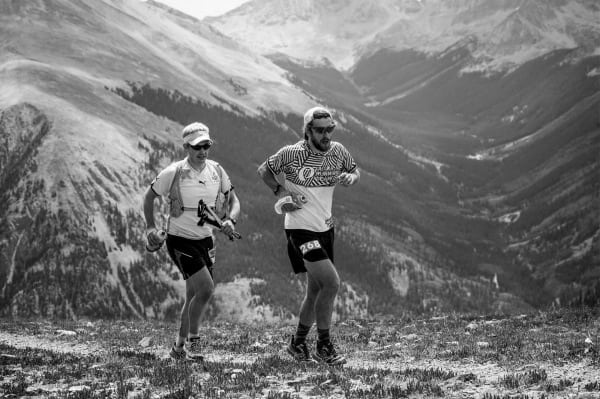 Nick Clark and his pacer running over Hope Pass