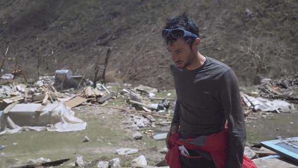 Kilian Jornet surveys bodies in Langtang Valley