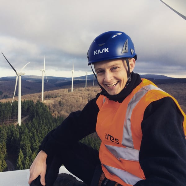 andy-symonds-sitting-on-top-of-a-wind-turbine