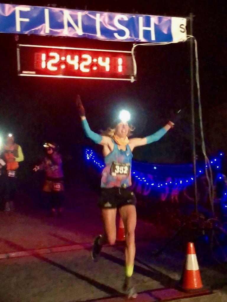 Camille Herron setting a new 100-mile world record at the Tunnel Hill 100 Mile - Conor Holt