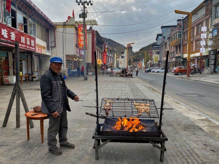 Grandpa roasting chicken
