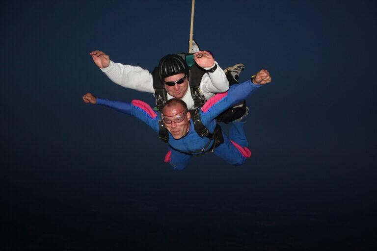 Tom Aussem skydiving (above))