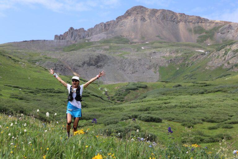 Runner up Darcy Piceu running through a field of wildflowers.