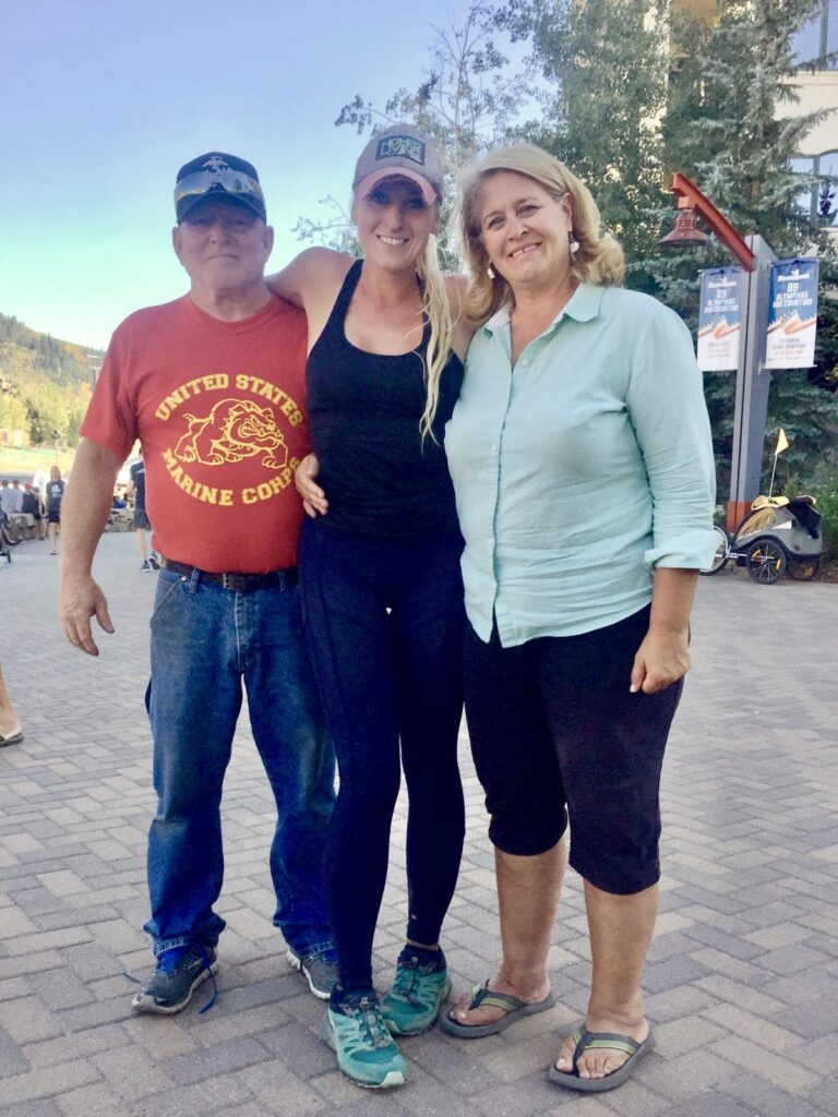 While Hall and her parents after the 2018 Run Rabbit Run 100 Mile
