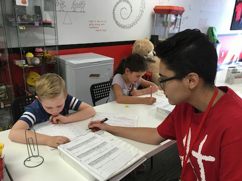 Mathnasium of Glendale's Education Director, Evette, working with a child on math