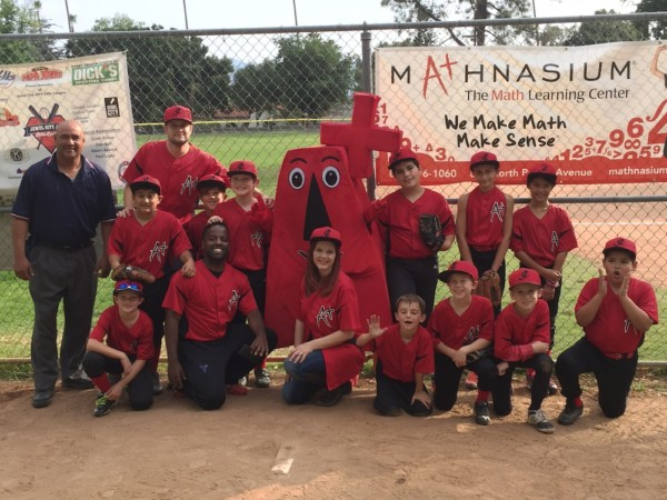 Mathnasium mascot posing with local little league